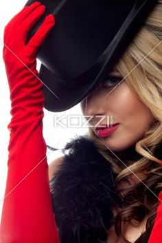 young fashionable woman posing with a hat. - Portrait of a young fashionable woman posing with a hat over white background, Model: Nadine Yelovich