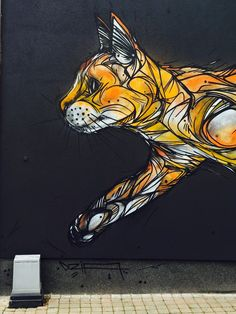 """DZIA paints """"Catflow"""", its newest mural on the streets of Zolder in Belgium"""