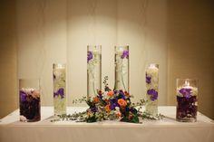 Great altar decor: Submerged blooms, candles & arrangement