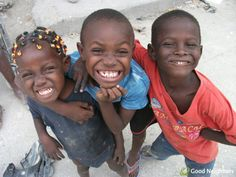 Big smiles from three kids in Haiti, where we're still working to rebuild communities for children and families: http://goodneighbors.org/haiti-relief