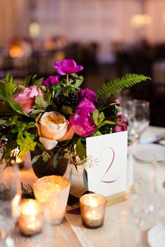 Purple, plum and peach Wedding Centerpiece at the Bryant Park Grill in NYC by Jessica Haley