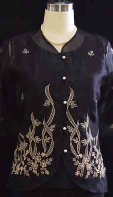 WOMEN'S BARONG #5162 PRICE:  $50.00 DETAILS: Simply lovely. Delicate #embroidery create a remarkably #feminine aesthetic in our button-front blouse. Color: Black Split Neckline 2 pc. blouse (transluscent blouse with matching inner garment) With delicate embroidered floral design 3/4 semi bell sleeves Semi fitted shape  #womensbarong #barongtagalogforwomen #barongsforwomen #filipino #filipina