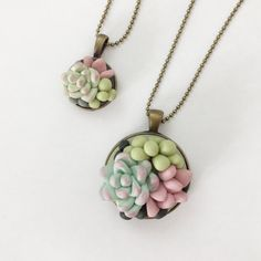 Polymer Clay Succulent pendant, handmade by me! Perfect for you or your mini!  I carefully mix the polymer clay to blend beautiful pastel colours and decorate with gold leaf. Available in small - 19mm and large - 40mm  Backs are brass or with an antique finish. Chain length is 70cm but please message if you require a different length.  I can also do custom orders!   Check out my other handmade items on http://www.clayandclasp.etsy.com  Please note that all my items are handmade, I use no…