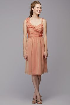 Asymetrical neckline with detailed neckline and flowy skirt. Available in several colors. Featured in chiffon.