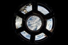 "This remarkable image was taken by ESA astronaut Luca Parmitano through the International Space Station's window onto the Earth – Cupola. Luca jokingly posted on Twitter: ""Proof that the Earth is indeed round""."