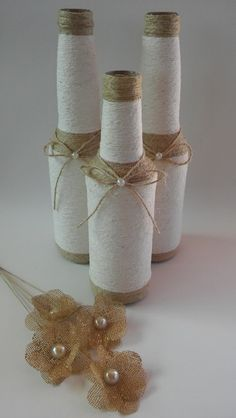 I love the burlap flowers near the bottles! Perfect to put into these rustic bottles. Twine Wrapped Bottles, Twine Wine Bottles, Recycled Wine Bottles, Painted Wine Bottles, Bottles And Jars, Glass Bottle Crafts, Wine Bottle Art, Diy Bottle, Reuse Bottles