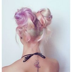Multicolored pastel hairstyle with buns - http://ninjacosmico.com/28-crazy-hairstyles-ideas/