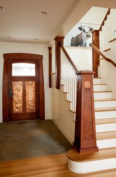 The lighthouse-evoking stair newel is a key feature of the beach house. All photos by Blackstone Edge Studios