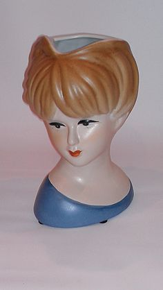 Lady Head vase--flowers make a hat for her!
