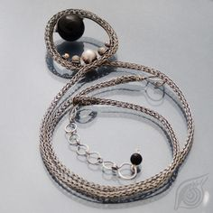 Dark matter rings in ring wire wrapped necklace black