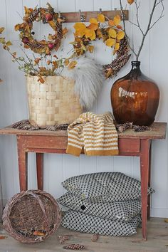 Love that HUGE dark amber jar.  It's the centerpiece of this beautiful fall vignette.