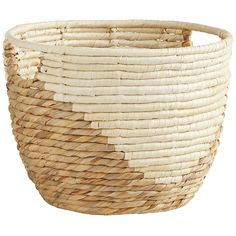 Hand-woven of water hyacinth and palm leaves by our skilled artisans, our Mila Round Basket adds updated style to your home. A distinctive palm triangle design brings a fresh new look to your bathroom, office or bedroom.
