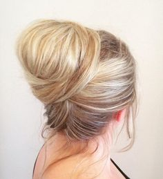 Wrap Around Bun - Twisting your hair up into a glamorous updo may be easier than you think! Just look at this lovely hairstyle, it's a simple bun with the hair wrapping around for a very enticing finish. Great choice for older women!