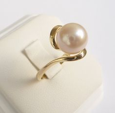 Pearl ring gold ring womens pearl engagement ring. $385.00, via Etsy.