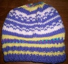 This Simple Colorwork Beanie is a perfect example of a colorwork knitting pattern that's not too easy but not too complicated. The fair isle knitting pattern in this hat is interesting enough to keep your attention, but not so difficult that it'll become confusing. This is an ideal hat knitting pattern for an advanced beginner who already knows how to work fair isle knitting patterns. If that sounds like you, then you have to give this knit hat pattern a try. Just choose 4 col...