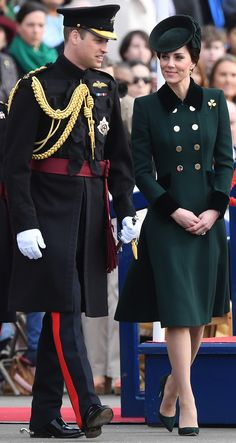 Kate Middleton Photos Photos - Britain's Prince William, Duke of Cambridge, (L) and his wife Britain's Catherine, Duchess of Cambridge visit the Irish Guards during a St Patrick's Day parade at Cavalry Barracks in Hounslow, west London on March 17, 2017. / AFP PHOTO / Justin TALLIS - The Duke And Duchess Of Cambridge Attend The Irish Guards St Patrick's Day Parade