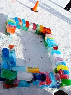 WInter ice castle made of frozen 2 litre milk cartons of water with a touch of food colouring.We love this project Thinking we will build one this summer!!