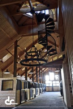 dcbuilding: A view down the breezeway of an incredible 24 stall equestrian facility in Baton Rouge, Louisiana. Ever wanted a barn with chandeliers and a spiral staircase? See more barns by DC Building.
