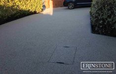Resin Bound Stone Driveway, Patios, Paths and Outdoor Spaces. We supply to Swansea, Cardiff, Newport and all surrounding areas in South Wales. Stone Driveway, Drain Cover, Swansea, South Wales, Newport, Outdoor Spaces, Resin, Sidewalk, Courtyards