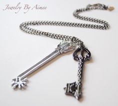 Double Keyblade necklace  Choose your keyblade  by JewelryByAimee, $25.20  --  Omg... he'd love this so much : 3!