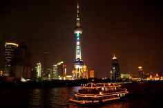 Shangai Night Skyline ---- Wonderful view of the Shanghai skyline at night. The tour we were on included a night cruise on the river. The sky needle thing is called the Oriental Pearl Tower. Wonderful view of the city from the top deck.