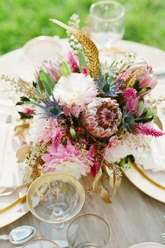 fascinating combination of pheasant feathers, protea, dahlias, gilded leaves and assorted wildlings..love the textures