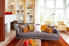 desire to inspire - Kind of a pillow party, but I love the cool gray sofa in that warm orange and yellow room! Condo Living Room, Living Room Red, Living Room Colors, Apartment Living, Home And Living, Living Room Decor, Grey Living Room With Color, Burnt Orange Living Room, Bedroom Orange