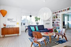 scandinavian color scheme for the music room/ library - lots of white, with pops of saturated color