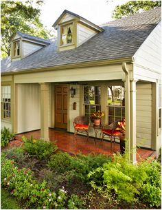Depending on the color of the house siding...painting the cement wrap around porch a bright color would be an amazing accent!