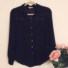 Tobi Black Button-Up with Heart Cut-Out This blouse from Tobi is adorable! It has gold buttons and cut-out hearts in the back. It is in excellent condition and a size medium. 100% polyester. Tobi Tops Button Down Shirts