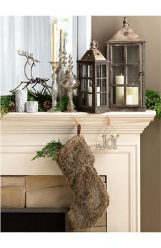 Family Gathering: Decorating the Mantle - love the lanterns, the greenery, the silver decor, and the woodsy/furry stocking!