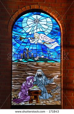 Church Window pane - angel announcing birth of Jesus Christ by Geo Martinez, via ShutterStock