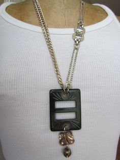 Love this vintage buckle necklace!