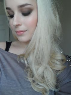 I love the blonde hair and the pale skin, and the makeup! She is so pretty!