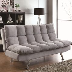 Bring a casual, transitional styling into your home with this sofa bed futon. It is upholstered in a light grey teddy bear fabric that is perfect for any living