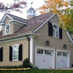 Love this carriage house garage!