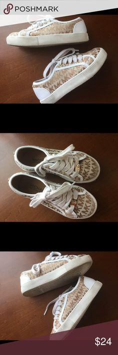 Michael Kors MK monogram kids tennis shoes Sz 12 White and gold monogram MK kids tennis shoes.  Have been worn, pre ❤️good condition MICHAEL Michael Kors Shoes Sneakers