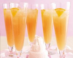 """""""Maid of Honor""""  1. Fill a tall glass with ice.  2. Add 1 oz vodka, 1/2 oz Amaretto, the juice of 1/4 fresh lemon and 2 oz each orange and cranberry juices.  3. Top with 2 oz soda water and garnish with an orange wheel."""