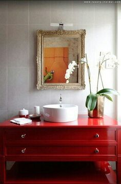 beautiful red lacquer vanity, needs a larger mirror and another sink. ..