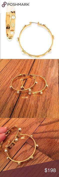 Brand New Tory Burch Pearl Hoop Earrings Brand new. Never worn Tory Burch Authentic pearl hoop earrings. Sold out everywhere. They are gold with beautiful pearly white. Laser cut out Tory logo. Dress up or dress down! Tory Burch Jewelry Earrings
