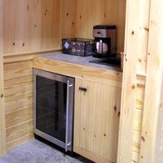 I like the mini fridge, sink, & mini kitchen area for my bedroom or basement family room!