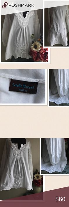 """Stella Forest Festival White Boho Tunic Stella Forest Festival White Boho Tunic. Detailed embroidery flower design at the front, on the sleeves and at the bottom of tunic. Elastic at the sleeve cuffs. Material 💯% cotton. Size: 40. Pit: 18.5"""" Length: 32"""". Gently washed & worn. Stella Forest Tops Tunics"""