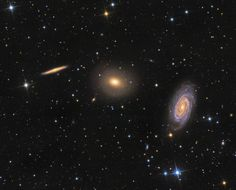 This intriguing trio of galaxies is sometimes called the Draco Group, located in the northern constellation of Draco. From left to right are edge-on spiral NGC 5981, elliptical galaxy NGC 5982, and face-on spiral NGC 5985. While the group is far too small to be a galaxy cluster and has not been catalogued as a compact group, these galaxies all do lie roughly 100 million light-years from planet Earth..