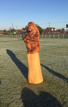Chainsaw carved 7ft monkey sitting  on a post out of spruce