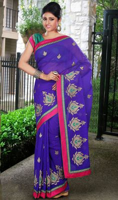Purple Embroidered Jute Silk Saree Purple shade jute silk saree features zari and resham embroidered decorative motifs and buttis. Contrast border completes the look. Comes with a matching stitched round neck blouse with 6 inches sleeves. #EmbroideredSilkSaree #BridalDesignerSarees