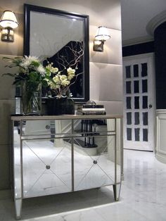 Don't be afraid of a little drama. A mirrored chest topped with a decorative mirror makes glamorous reflection a design motif.