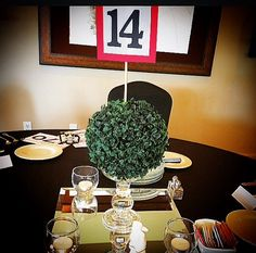 Alice & Wonderland non floral DIY centerpieces with faux kissing balls aka pomanders.  See the cute little white rabbit?   #charity #auction #canterwood #gigharbor #aliceandwonderland #clubcorp