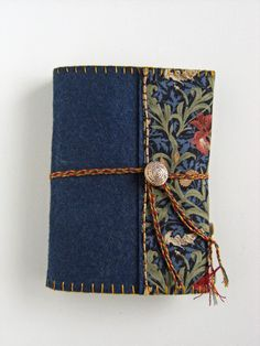 Blue Iris - Wool Felt Embroidered Journal with Iris design lining and trim, hand embroidered decoration. Hand-plaited cord & metal button wrap-closure, with enamelled lily drop detail.