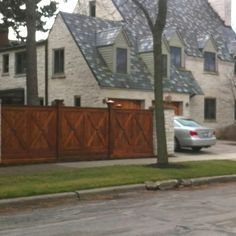 Love everything about this house! From the shingles to the stone to the wood fence with copper topped posts