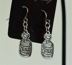 Name your Poison, is a unique pair of earrings with moonshine jars. Something quirky to wear that is sure to spark conversation.